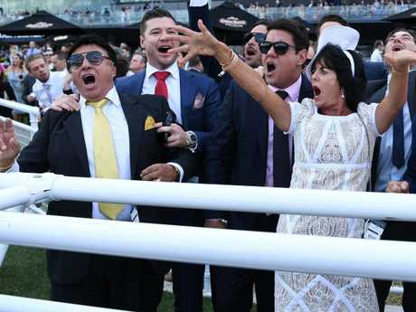 Bert Vieira (left) and wife Gai (right) celebrate their horse Trapeze Artist winning at Randwick in April this year. Picture: David Moir