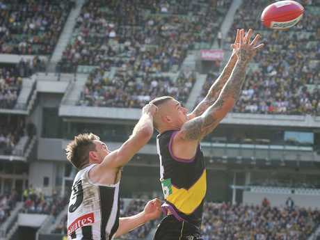 Dustin Martin marks in front of Levi Greenwood in Round 19. Picture: Michael Klein