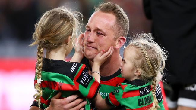 Jason Clark hugs his daughters Milla and Andi after the Rabbitohs' nail-biting victory over the Dragons. Picture: Getty Images