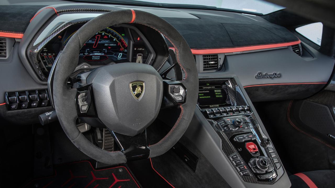 The Aventador's cockpit resembles a fighter jet's.