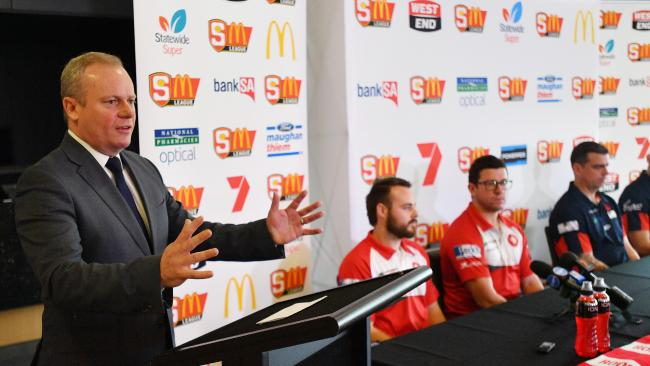 SANFL chief executive Jake Parkinson with the North Adelaide and Norwood coaches. Picture: David Mariuz/AAP