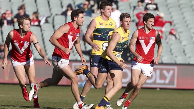 North Adelaide's Aidan Tropiano, second from left, at the start of the final quarter of Sunday's preliminary final. Picture: Sarah Reed