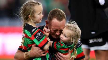 Jason Clark sheds tears as he hugs daughters Milla and Andi. Picture: Getty Images