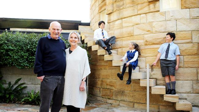 Bob and Jennifer Wright with grandkids Lucia, 11, Henry, 14 and Jonathan, 11, at their Castle-like home on the north shore. Picture: Tim Hunter.
