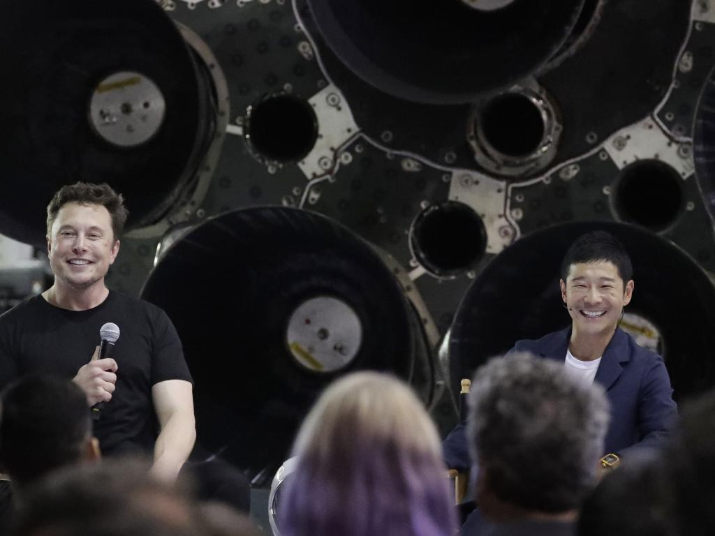 SpaceX founder and chief executive Elon Musk, introduces Japanese billionaire Yusaku Maezawa who will be the first private passenger on a trip around the moon. Picture: Chris Carlson/AP