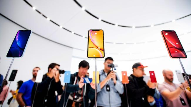 Apple iPhone Xr models rest on display during a launch event on September 12, 2018. Picture: Noah Berger
