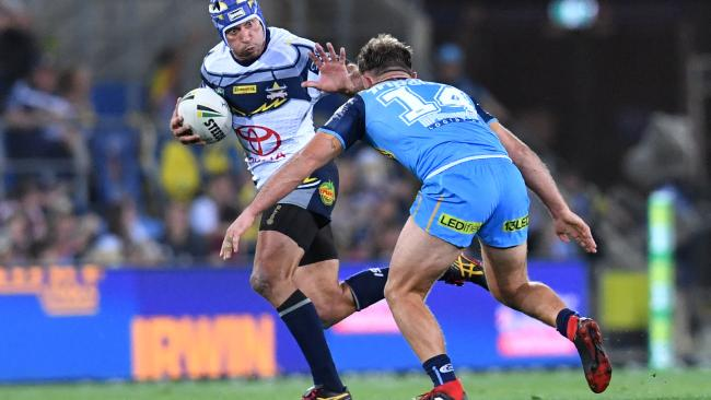 Johnathan Thurston takes on the Titans in his final game of NRL on the Gold Coast. Photo: AAP