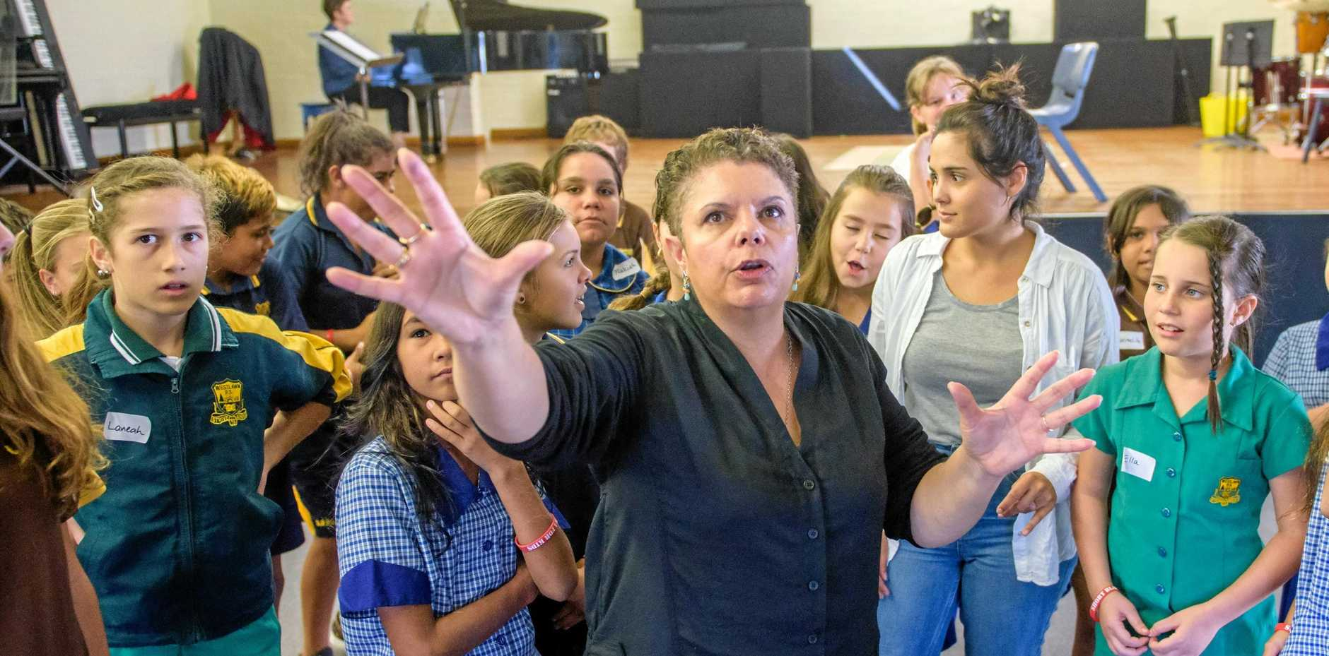 ON SONG: Opera singer Deborah Cheetham tutors local indigenous students in singing as part of a week-long residency at the Clarence Valley Conservatorium in 2016. Ms Cheetham has been critical of the Australian national anthem, refusing to sing it at a grand final because of its absence of indigenous recognition.