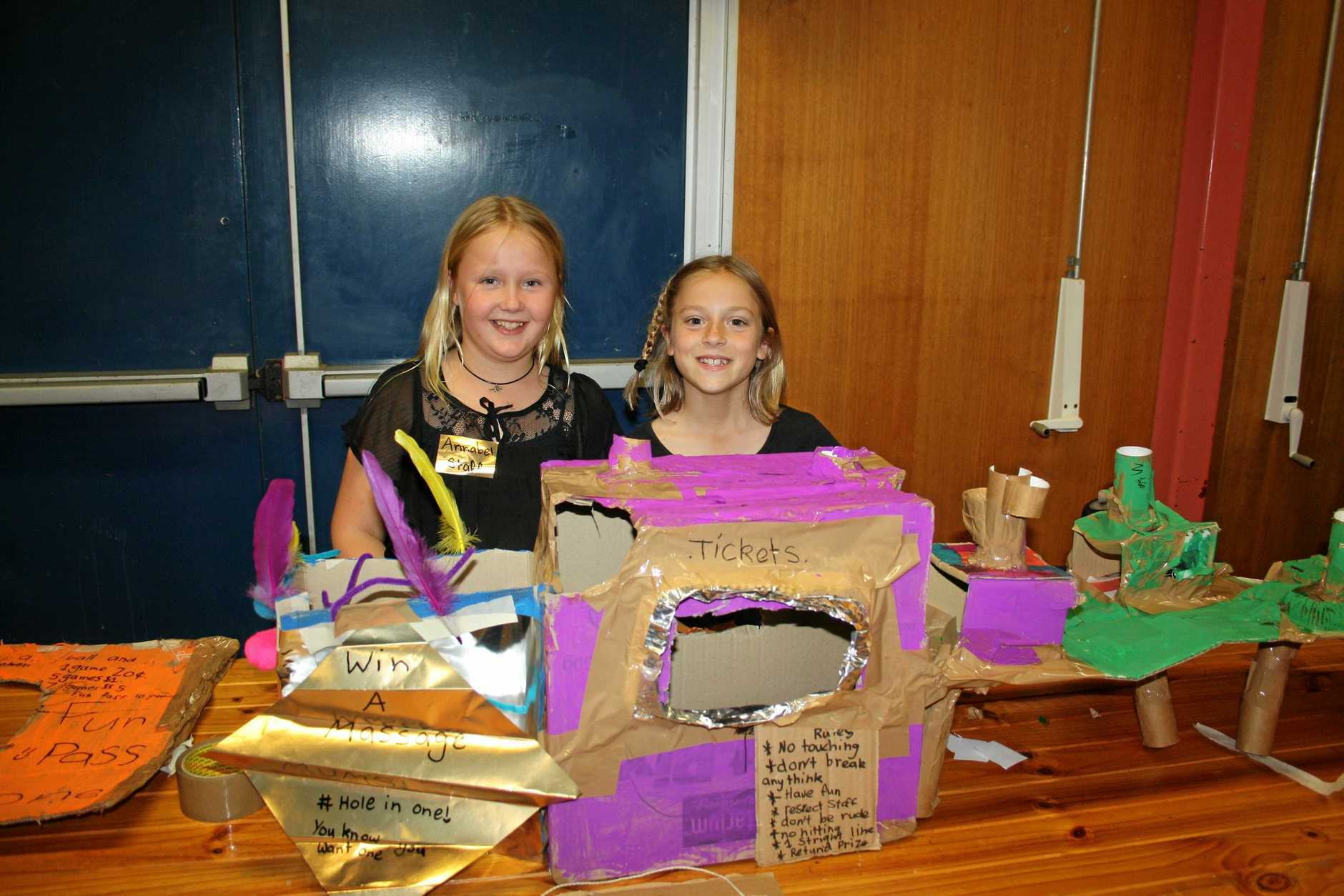 Year 4 students Annabel Dungey and Lexi Bryant showing off their 'Hole in One' pinball game.