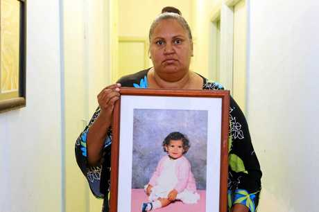 Michelle Jarrett with a photo of her niece Evelyn Greenup, one of the three Aboriginal children murdered in Bowraville almost three decades ago.