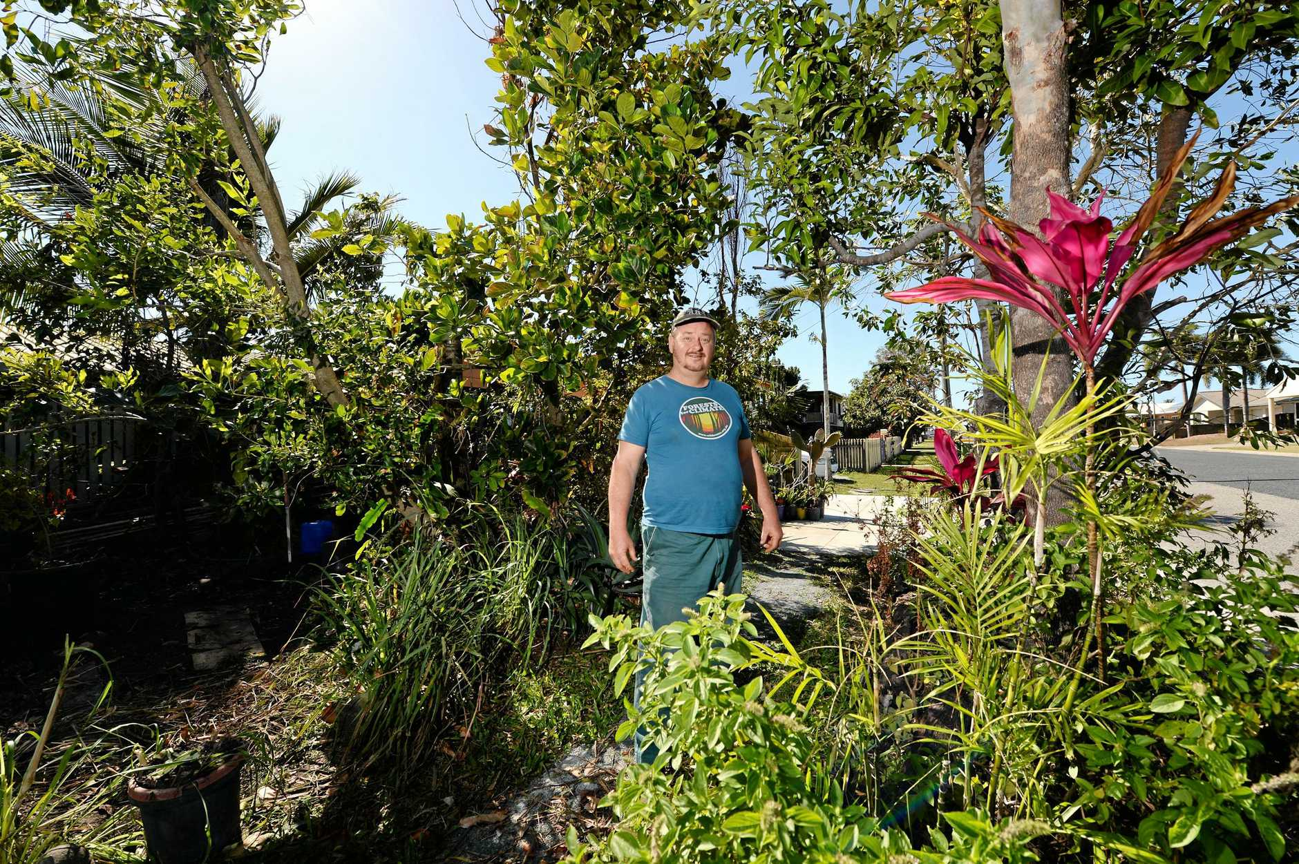 South Mackay resident Larry Murchie in his front garden that has raised the ire of Mackay council