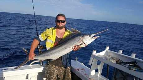 Mitch McGregor with a six-foot long black marlin caught at Rock Cod Shoals.