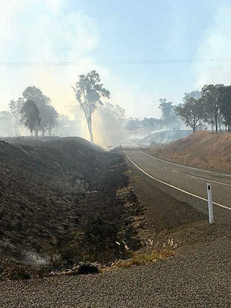 A raging bushfire at Woolooga continues to worsen and threaten the township as terrified residents prepare to leave.