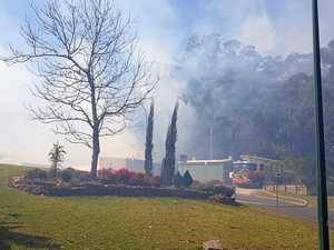 Bushfire burning behind education campus