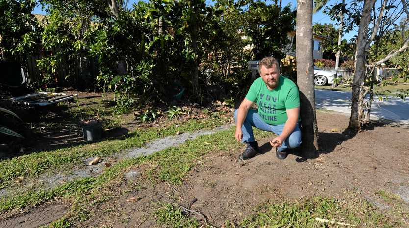 Larry Murchie on the footpath at his South Mackay rental  after his garden was removed by Mackay Regional Council.