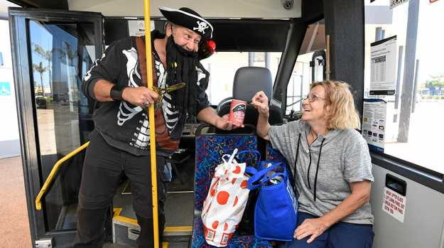 Talk like a pirate day - Wide Bay Transit bus driver Dave Brannelly gets a donation from Linda Catterson of Torquay.