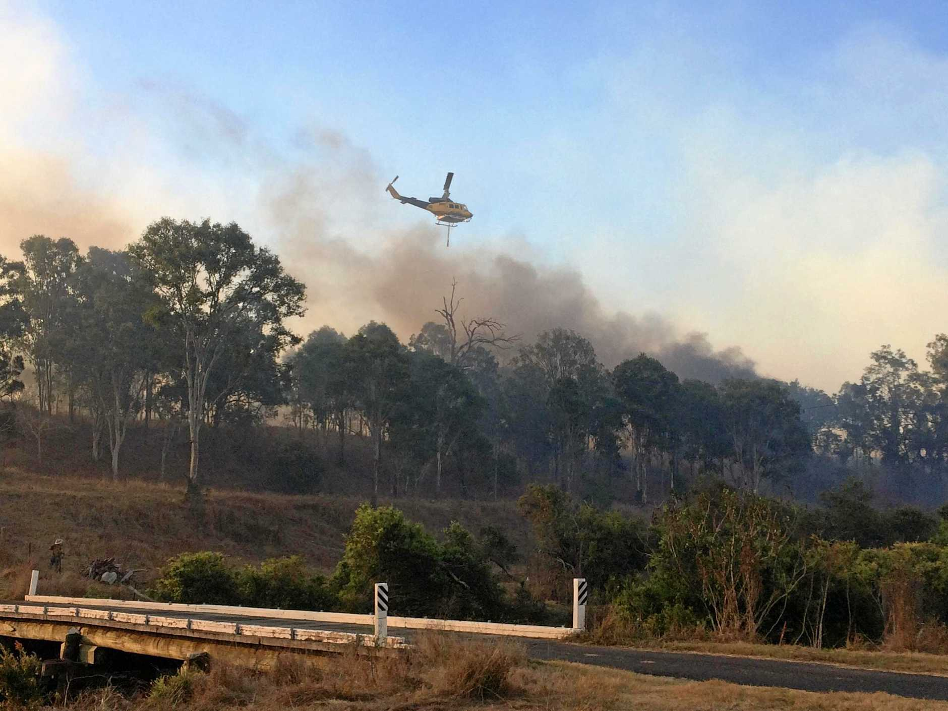 A raging bushfire at Woolooga continued to worsen and threaten the township as terrified residents prepared to leave yesterday.