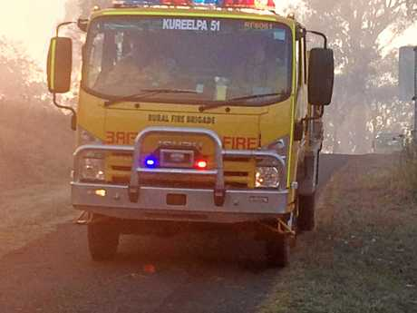 A raging bushfire at Woolooga continued to worsen and threaten the township as terrified residents prepared to leave on Wednesday.