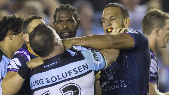 William Chambers of the Storm and Paul Gallen of the Sharks rumble at the end of the Round 4 NRL match between the Cronulla-Sutherland Sharks and the Melbourne Storm at Southern Cross Group Stadium in Sydney, Friday, March 30, 2018. (AAP Image/Craig Golding) NO ARCHIVING, EDITORIAL USE ONLY