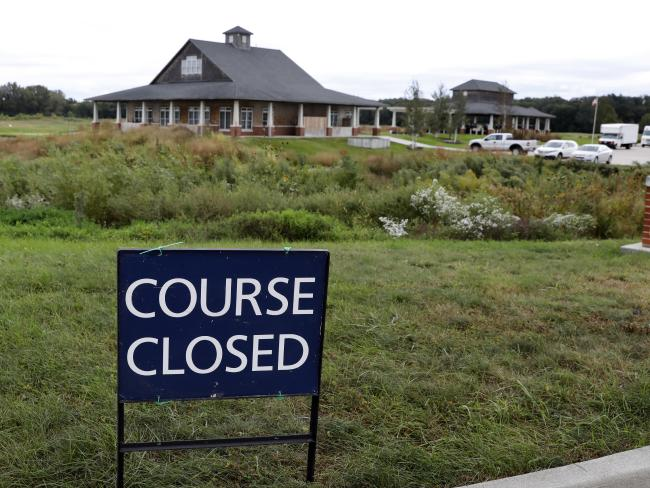 A course closed sign sits in front of the Coldwater Golf Links course where the body of Celia Barquin Arozamena was found. Picture: AP