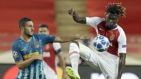 Monaco midfielder Kevin Ndoram controls the ball as Atletico midfielder Koke looks on. Picture: AP