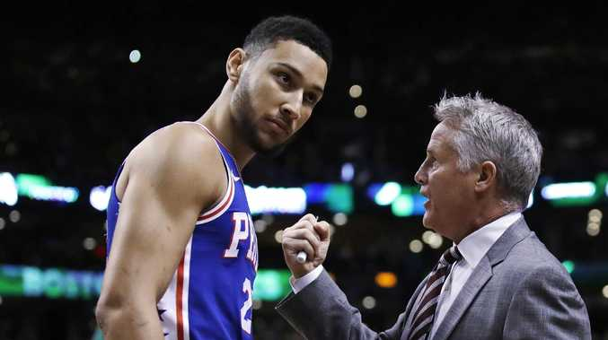 FILE — In this Wednesday, May 9, 2018 file photo,Philadelphia 76ers coach Brett Brown, right, talks with guard Ben Simmons before Game 5 of the team's NBA basketball playoff series against the Boston Celtics in Boston. Philadelphia 76ers coach Brett Brown is expecting more out of guards Ben Simmons and Markelle Fultz this season. The guards failed to hit a 3-pointer last season. Brown says the du