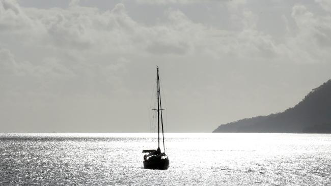 A yacht anchored at the entrance to Trinity inlet. PICTURE: JUSTIN BRIERTY