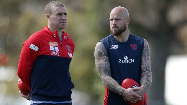 Melbourne coach Simon Goodwin and Nathan Jones chat during training. Picture: Michael Klein