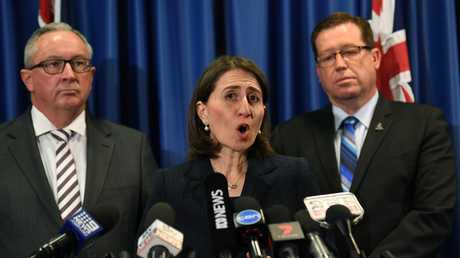 Health Minister Brad Hazzard with Premier Gladys Berejiklian and Police Minister Troy Grant on Tuesday. Picture: AAP