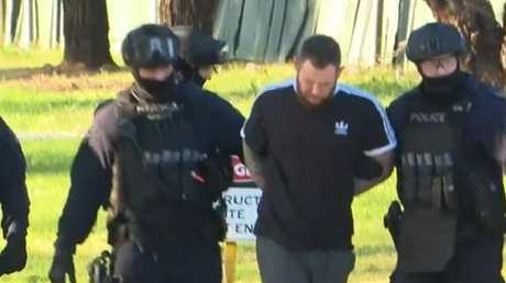 Mr Hogg was arrested after a tense stand-off with police. Picture: Channel 9.