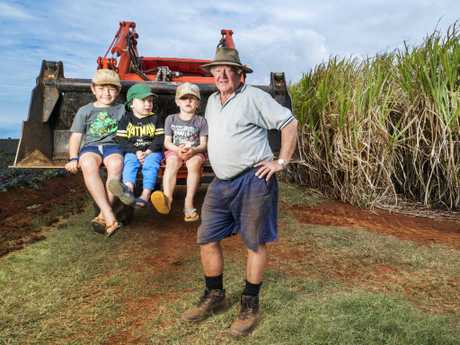 Brian Cautice - pictured with grandsons Flynn, 4, Connor, 3, and Thomas, 7 -  has just got out of canegrowing and turned to sweet potatoes as the poor price of sugar made it uneconomical to produce. Picture: Lachie Millard