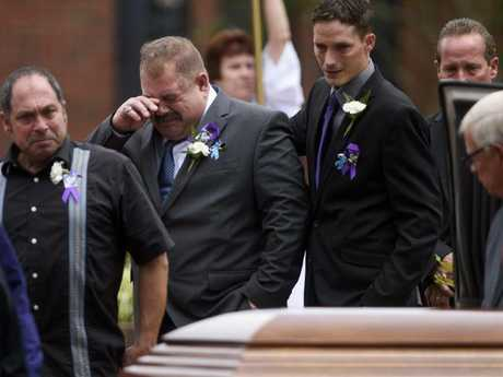 Family members of Shanann Watts and her daughters Bella and Celeste become emotional as they pass Shanann's casket after a funeral mass at Sacred Heart Catholic Church in Pinehurst, North Carolina. Picture: AP