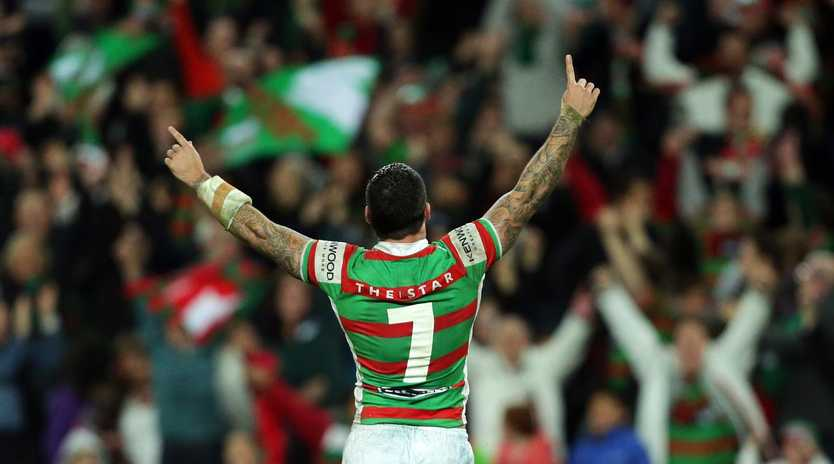 Adam Reynolds celebrates victory after converting his winning try in the famous 2012 game against the Roosters.