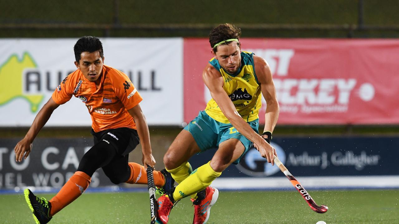 Australia's Flynn Ogilvie tries to dodge Malaysian opponent Haziq Samsul at Marrara. Picture:  Katrina Bridgeford