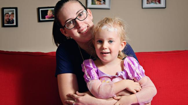 Jenna Graefling and her 3-year-old daughter Alice-Anne Lee who was unable to be treated at the Palmerston Regional Hospital after splitting her head open  on Saturday