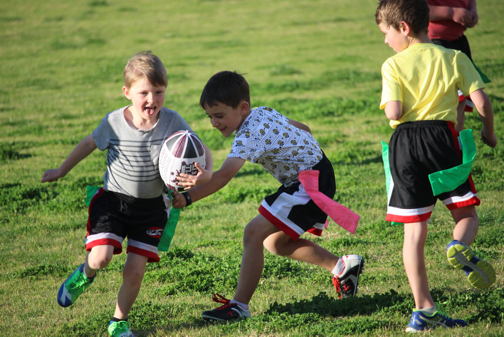 Image for sale: Oztag under 6s players had nothing but smiles in the first two rounds of oztag.