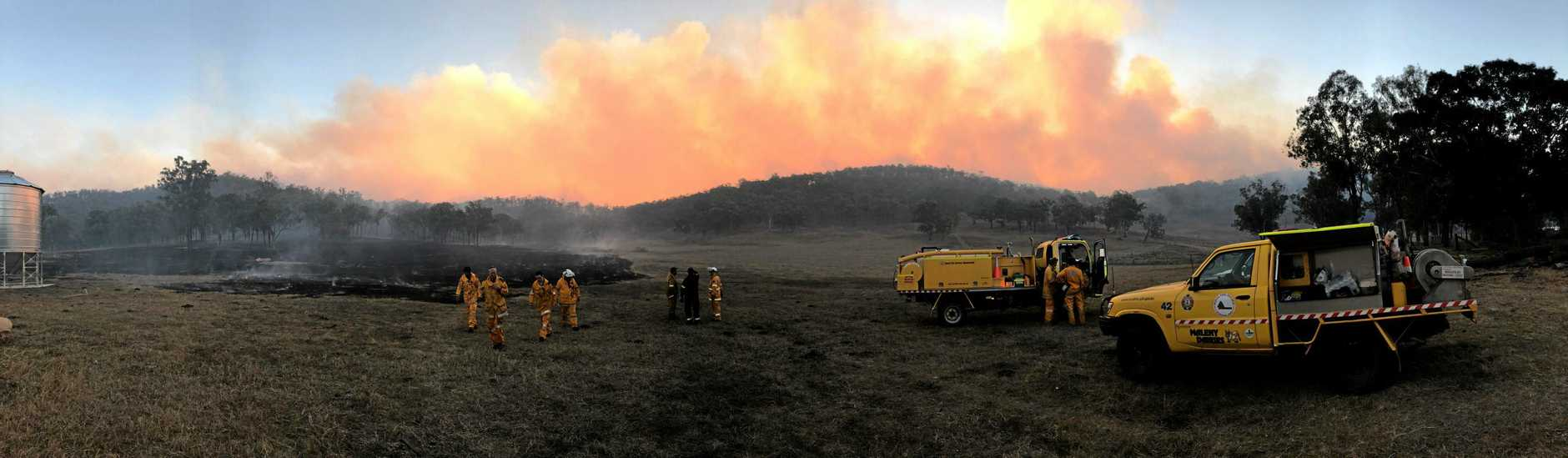 The Woolooga grass fire destroyed millions of dollars worth of fencing, cattle yards and water tanks overnight leaving cattle burned and volunteer rural brigades exhausted.