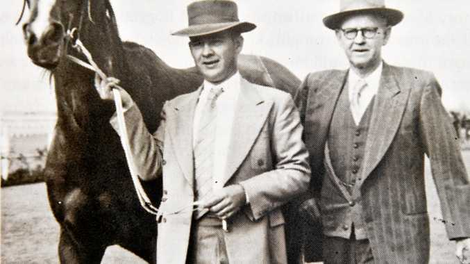Con Doyle (right) and his son Tom with Lucky Leader after a Doomben victory in the 1950s.