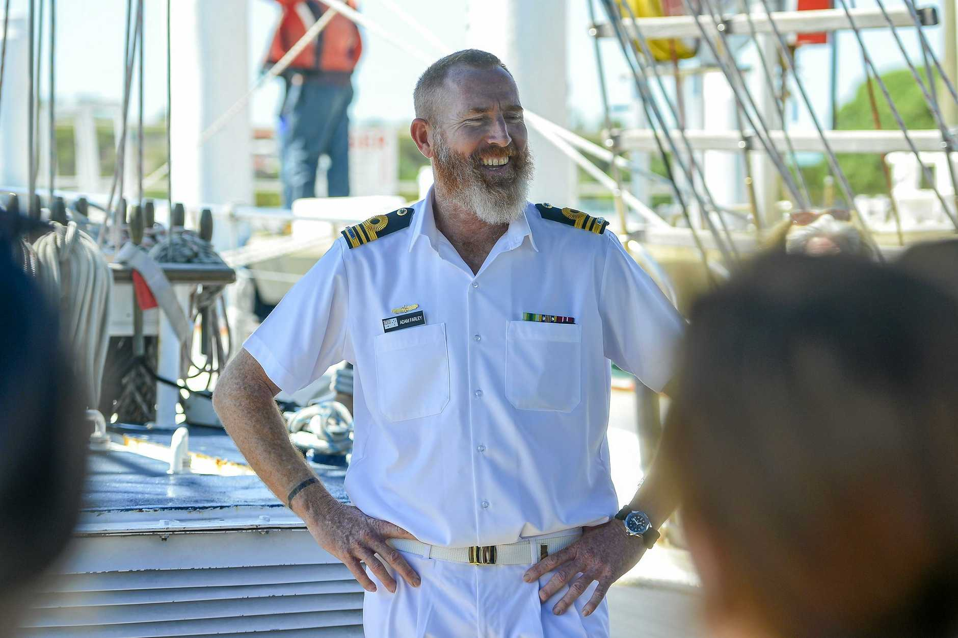 Lieutenant Commander Adam Farley led the STS Young Endeavour as it sailed into the Gladstone Marina.