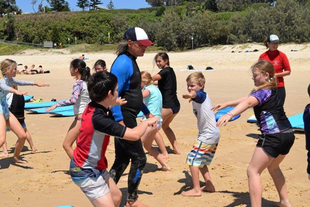 OCEANS OF FUN: Dean Marshall and Rainbow Beach Learn to Surf owner Sarah Booth gave lessons to the visitors.