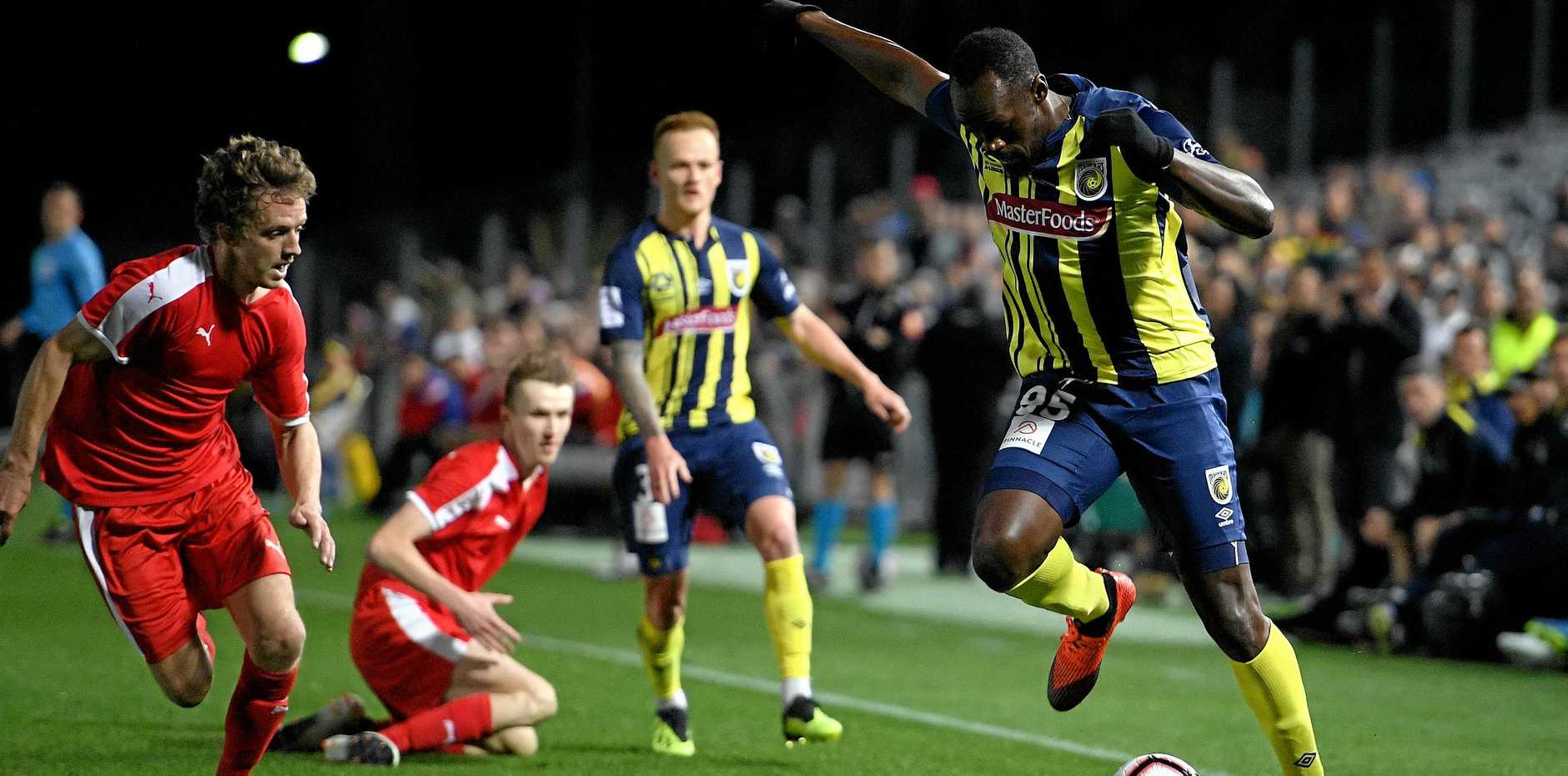 Usain Bolt on the run Mariners in their A-League trial match against the Central Coast Select XI at Central Coast Stadium in Gosford on August 31.  Picture: Dan Himbrechts/AAP