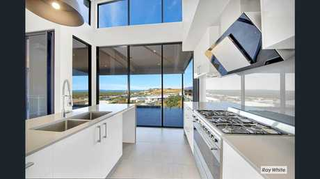 HOUSE OF THE WEEK: The modern kitchen/dining/living area has a beautiful view of the coast and Keppel Islands.