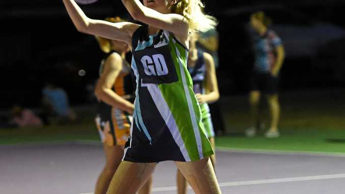 TAKING THE SHOT: Kirra Murdoch from the Reckless Rhinos on the court against the Brumbies Bandits in Junior Division 2.