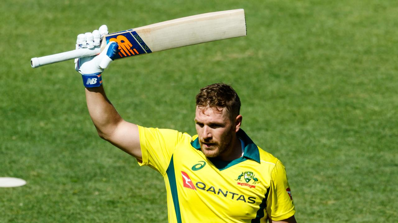 Australia's captain Aaron Finch waves to the crowd as he walks off the pitch after losing his wicket during the third match played between Australia and hosts Zimbabwe as part of a T20 tri-series. Picture: AFP PHOTO
