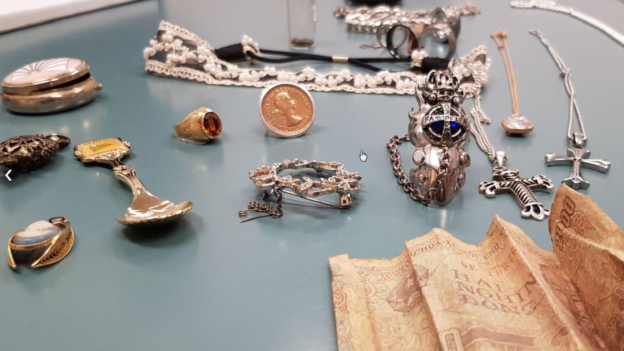 Jewellery, coins and other items found by police after raids in Mackay.