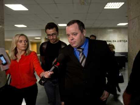 Mauricio Eduardo Mayr, centre, is the lawyer representing Marcelo Ferreira dos Santos Santoro. Picture: AP Photo/Silvia Izquierdo