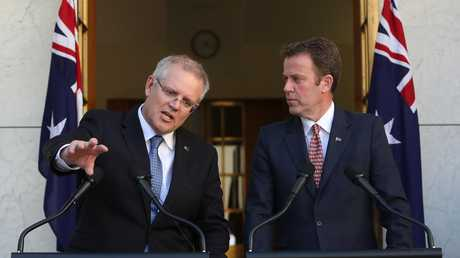 PM Scott Morrison and Minister for Education Dan Tehan spruik the deal at a press conference at Parliament House in Canberra. Picture: Kym Smith