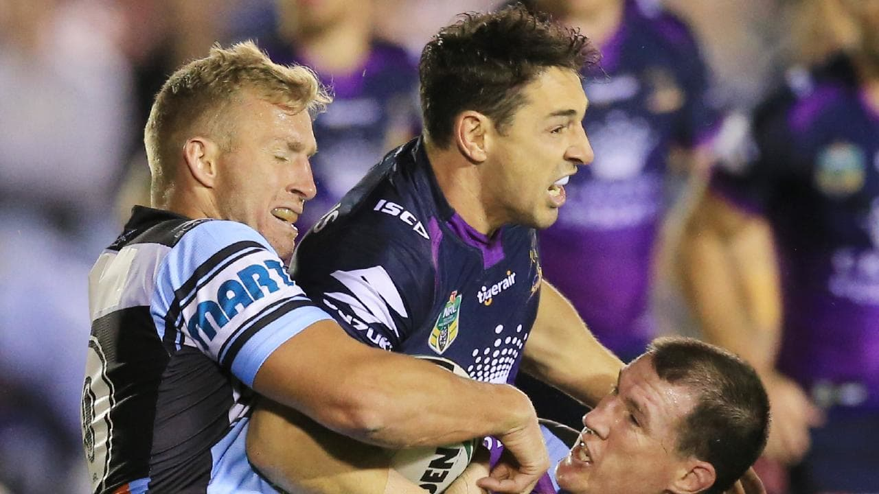 The Storm's Billy Slater is tackled by Paul Gallen and Matt Prior. Picture: Mark Evans