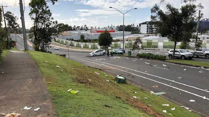 Debris litters Ashmore Road after four men who allegedly kidnapped nurse Joesph Brooker tried to flee the area. Photo: Amanda Robbemond