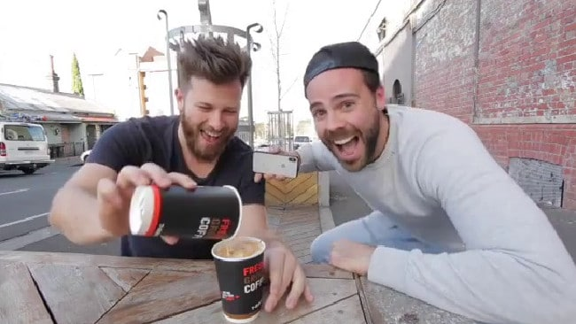 The Daily Talk Show podcast host Tommy Jackett, right, and co-host Ryan Jon expose the 7-Eleven coffee cup 'scam'. Picture: @tommyjackett/Instagram